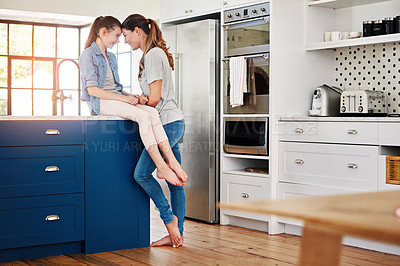 Buy stock photo Shot of a mother and daughter spending time together at home