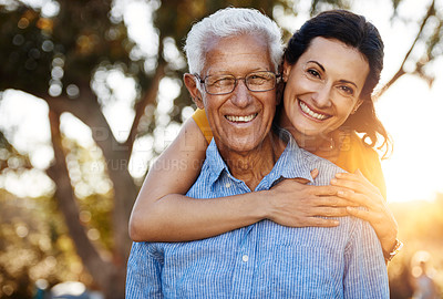 Buy stock photo Portrait of happy woman posing outside with her mature father