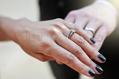 Buy stock photo Cropped shot of a newlywed couple wearing their wedding rings