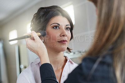 Buy stock photo Shot of a beautiful bride having her makeup done by her makeup artist