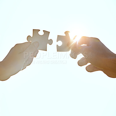 Buy stock photo A cropped shot of hands holding puzzle pieces