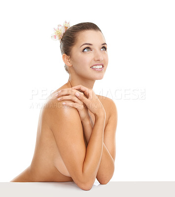 Buy stock photo Cropped portrait of a young nude woman looking away with a smile