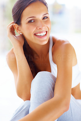 Buy stock photo Portrait of happy young lady in sportswear sitting on ground and smiling