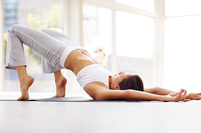 Buy stock photo Portrait of healthy young woman practising yoga exercise on mat at home