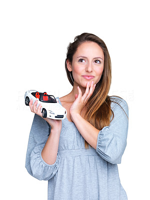 Buy stock photo Portrait of a cute young woman planning to buy a new car against white background - copyspace