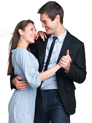 Buy stock photo Portrait of a cute young couple dancing together against white background