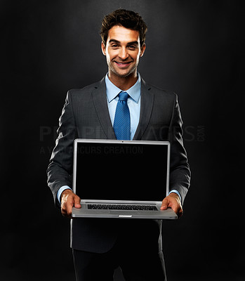 Buy stock photo Portrait of business man holding his laptop and smiling on black background