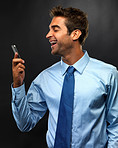 Young business man reading text message and laughing