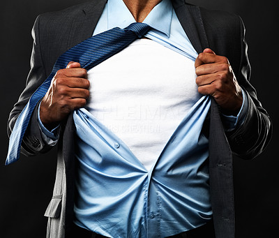 Buy stock photo Cropped view of frustrated business man tearing off his shirt to reveal white t-shirt for copyspace, isolated on black background