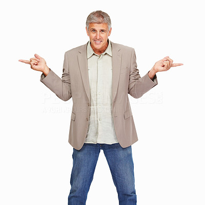 Buy stock photo Studio shot of a mature man pointing in opposite directions with both hands against a white background