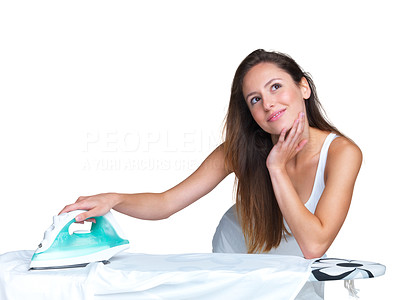 Buy stock photo Portrait of a beautiful young woman lost in thought while ironing clothes against bright background