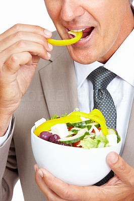Buy stock photo Closeup of business man eating vegetable salad on white background