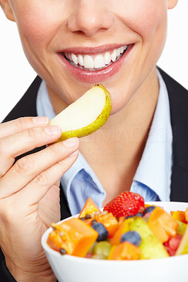 Buy stock photo Cropped closeup of a business woman eating a slice of pear from a bowl of fruit, isolated on white