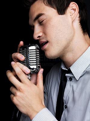 Male star singer singing with old fashioned microphone