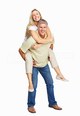 Buy stock photo Full length of mature man giving woman piggyback ride on white background