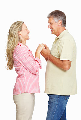 Buy stock photo Portrait of mature couple holding hands over white background
