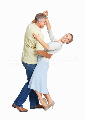 Buy stock photo Full length of beautiful mature couple dancing over white background