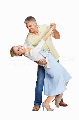 Buy stock photo Full length of romantic mature couple dancing together over white background