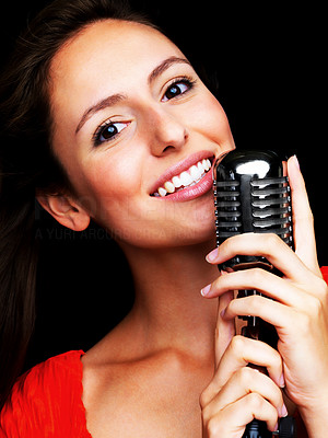 Buy stock photo Closeup portrait of a happy young female star singer singing with old fashioned microphone
