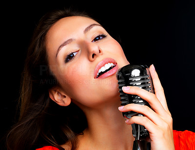 Buy stock photo Closeup portrait of a beautiful young female star performer singing with old fashioned microphone