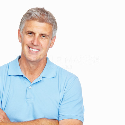 Buy stock photo Portrait of mature man smiling with arms crossed over white background - copyspace