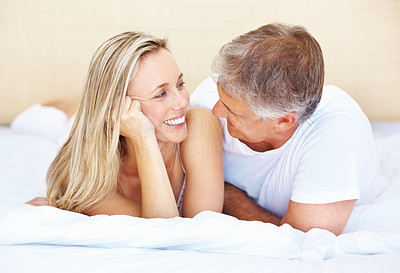 Buy stock photo Portrait of lovely couple spending romantic time lying in bed at home