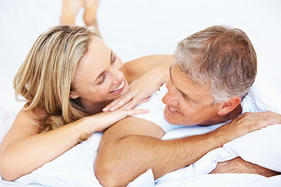 Buy stock photo Portrait of mature couple in love resting together in bed at home