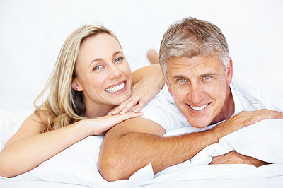 Buy stock photo Portrait of happy mature couple in love relaxing together in bed at home