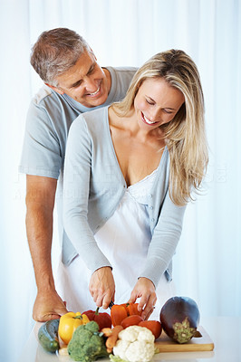 Buy stock photo Portrait of cute mature couple preparing meal at kitchen