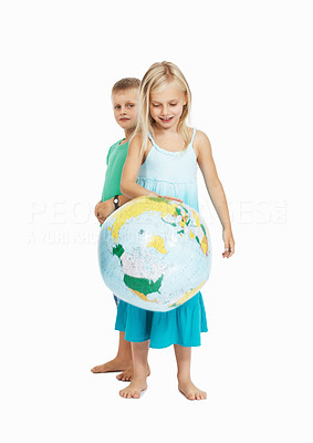 Buy stock photo Portrait of young children playing with the globe on white background