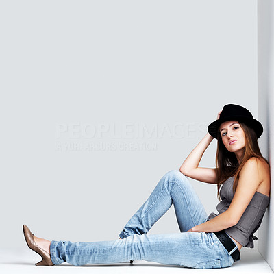 Buy stock photo Portrait of a beautiful young female model posing against grey background