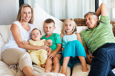 Buy stock photo Portrait of a happy family relaxing together at home
