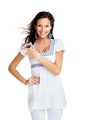 Buy stock photo Portrait of a smiling young female pointing at something interesting against white background