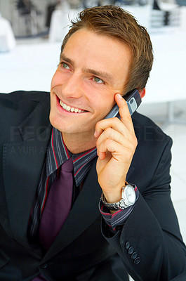 Buy stock photo Businessman making a phone call.  The concept of the picture is successfulness, surplus and energy.