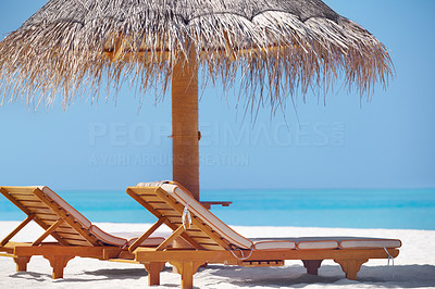 Buy stock photo Beautiful view of beach with two resting chairs and umbrella