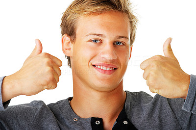 Buy stock photo Studio shot of a young man giving the thumbs up isolated on white