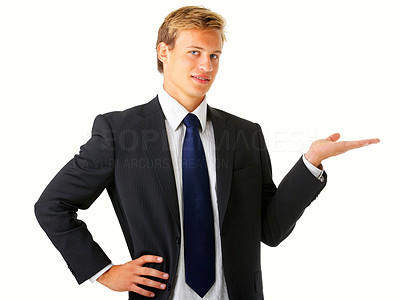 Buy stock photo Studio shot of a young businessman holding up copyspace isolated on white