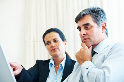 Buy stock photo Successful business people looking at laptop display in office