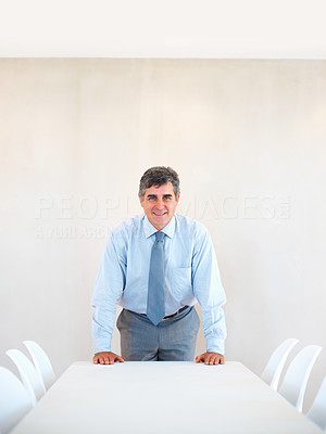 Buy stock photo Portrait of smart and confident mature business man at the empty conference room