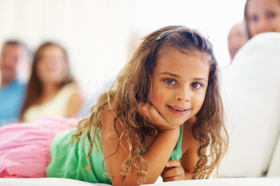 Buy stock photo Closeup portrait of a little kid relaxing with family sitting in the background