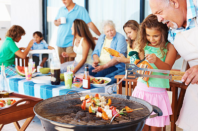 Buy stock photo Family having a barbecue party - little girl and grandfather at the barbecue grill