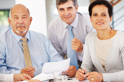 Buy stock photo Portrait of three executives with business document
