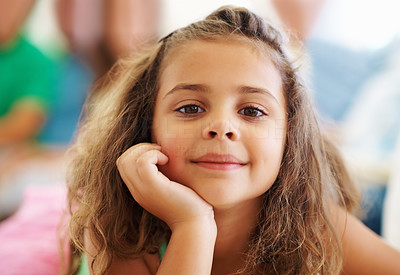 Buy stock photo Closeup portrait of cute little girl with family in the background