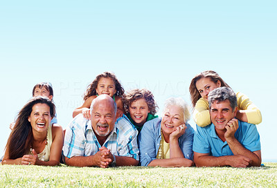 Buy stock photo Portrait of happy three generation family lying on grass - copyspace