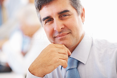 Buy stock photo Closeup of confident business man with colleagues discussing in background