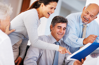 Buy stock photo Group of successful business people discussing project during meeting