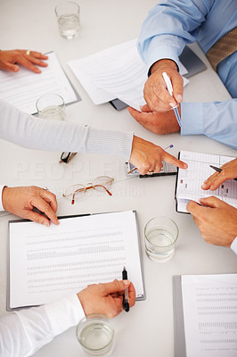 Buy stock photo Top view of hands with financial charts at business meeting in the office