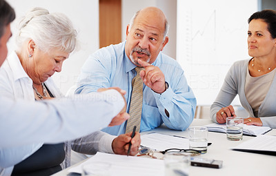 Buy stock photo Senior business man shaking hands with colleagues during meeting
