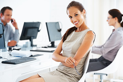 Attractive executive smiling at work