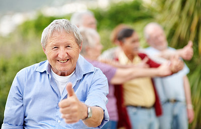 Happy senior man giving you thumbs up - Outdoor